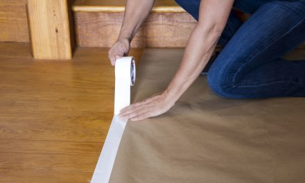 Can I apply painter's tape to wood flooring?